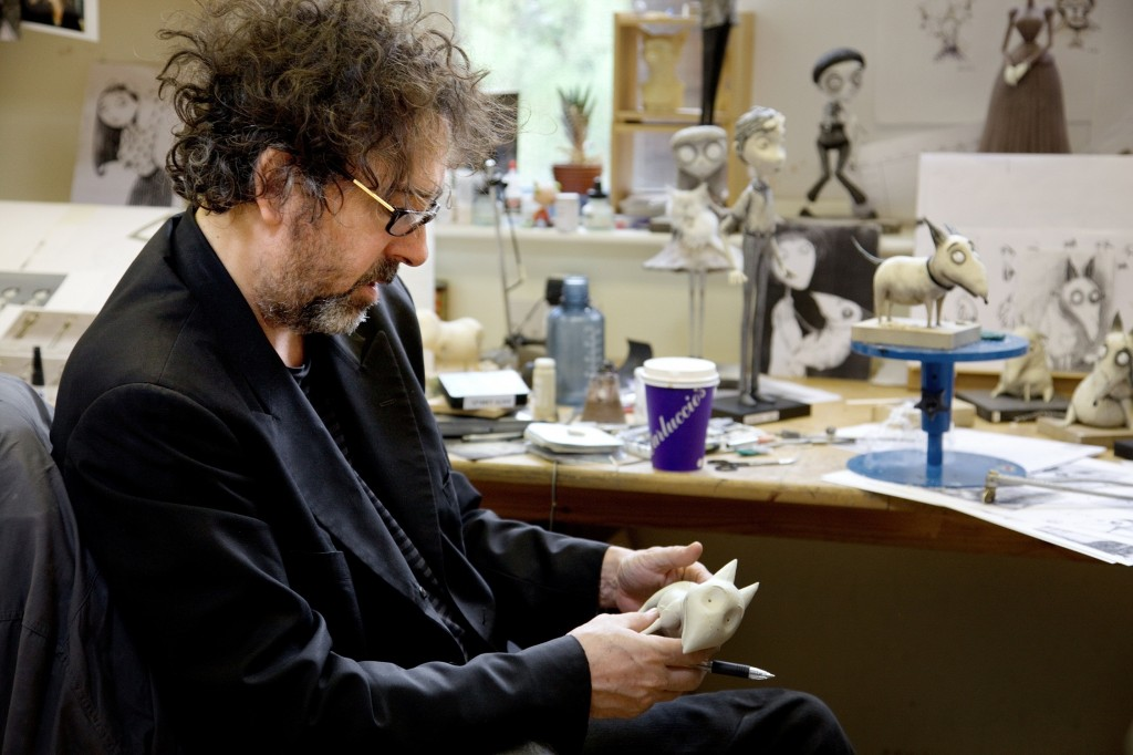 """""""FRANKENWEENIE""""  Director/Producer Tim Burton studies a model of Sparky during the making of"""