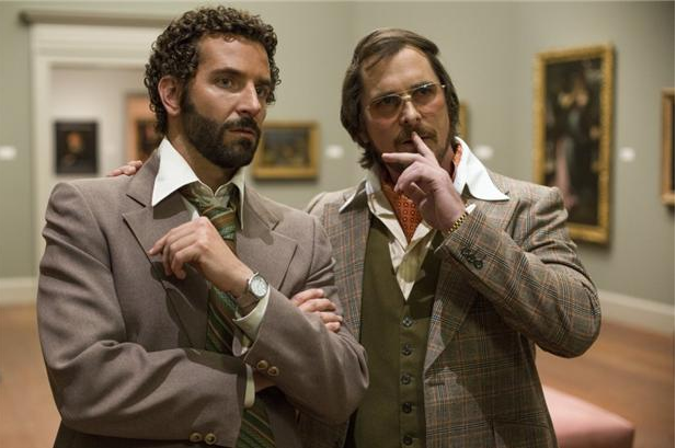 Richie Dimaso (Bradley Cooper, left) and Irving Rosenfeld (Christian Bale) talk in a gallery at the Frick Museum in Columbia Pictures' AMERICAN HUSTLE. PHOTO BY: Francois Duhamel COPYRIGHT: 	© 2013 Annapurna Productions LLC All Rights Reserved.