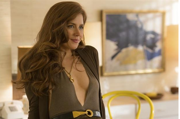 Sydney Prosser (Amy Adams) sits on the counter in her Upper Eastside Apartment in Columbia Pictures' AMERICAN HUSTLE. PHOTO BY: Francois Duhamel COPYRIGHT: 	© 2013 Annapurna Productions LLC All Rights Reserved.