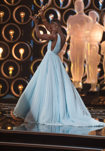 "Lupita Nyong'o accepts the Oscar® for Performance by an actress in a supporting role for her role in ""12 Years a Slave"" during the live ABC Telecast of The Oscars® from the Dolby® Theatre in Hollywood, CA Sunday, March 2, 2014. credit: Michael Yada / ©A.M.P.A.S."