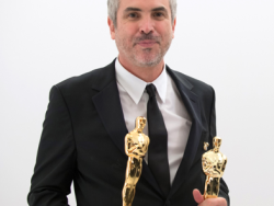 "After winning the category Achievement in directing and film editing for work on ""Gravity"", director Alfonso Cuarón poses backstage with his Oscar®. The Oscars® are presented live on ABC from the Dolby® Theatre in Hollywood, CA Sunday, March 2, 2014.  credit: Matt Petit / ©A.M.P.A.S."